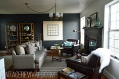 Living Room Makeover | Vintage Revivals. Click through to see more photos of this gorgeous makeover! I love the use of thrift store items and natural elements, and that dark wall adds so much sophistication!