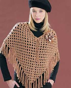 The coolest crochet poncho. Simple openwork pattern is finished off with fringe and a pretty tie at the neck. Sizes XS-5XL. Shown in Bernat Satin #04011 (Sable). Size 4.5 mm (U.S. 7) crochet hook.
