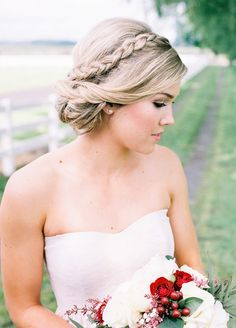 The single braid is one of our favorite looks right now. An otherwise simple up-do is boosted to a whole new level of romantic with a sweet braid running down the side. Photo by Alexandra Grace Photography
