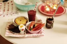 Chocolate scones, broiled grapefruit, boiled egg, watermelon, raspberry/blueberry smoothie