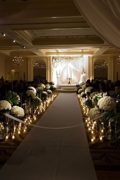 I like the fact that only the bride & groom's stage is lighted and also the aisle for that dramatic effect