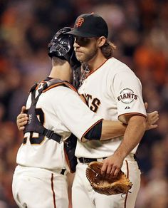 San Francisco Giants catcher Buster Posey, left, embraces pitcher Madison Bumgarner after the Giants defeated the Colorado Rockies 3-0 in a baseball game Tuesday, Aug. 26, 2014, in San Francisco. Bumgarner allowed Colorado only one hit