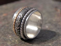 Sterling Silver spinner ring with hammered band and 3 other stacker rings including 14 karat gold filled