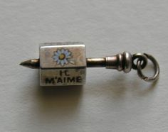 """Antique French """"He Loves Me,  He Loves Me Not """" Daisy Spinner 900 Silver Charm, $225.00"""