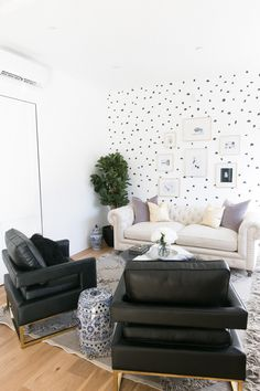 The conversation area of glamorous dreams (featuring a DIY polka dot painted wall!)