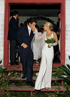 Carolyn Bessette in Narciso Rodriguez with husband John F. Kennedy Jr.