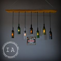 I think this is what Dave's thinking of making  (Repurposed Wine Bottle Seven Pendant by IndustrialArtifact on Etsy)