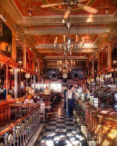 """""""A Brasileira"""" - One of the symbols of Lisbon. In the 19th Century this Cafe was visited by well known writers. At the entrance you can see a statue of Fernando Pessoa, one of the most important Portuguese intelectual personalities."""