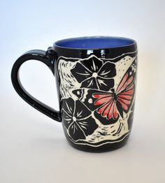 Butterfly mug. Handthrown stoneware mug. Design carved into clay using sgraffito technique