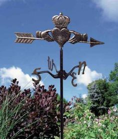 I love this.. an Irish Claddagh weather vane for the garden.