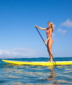 Stand-up paddleboardinging (SUP) is an amazing way to tone your whole body without feeling like you're exercising (Because it's fun, but it's not so easy.)