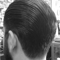Nice clean slickback with medium tapered edges. Finished with Uppercut Deluxe Pomade.