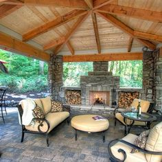 outdoor living area with outdoor fireplace - WWW.PARADISERESTORED.COM