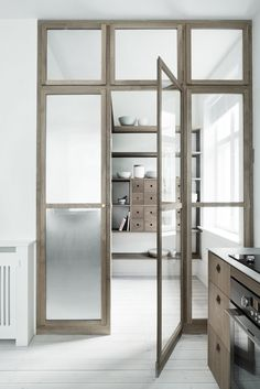 Heidi Lerkenfeldt for Gubi - via Coco Lapine Dekru iron framed doors taatsdeuren stalen deuren pivot deuren