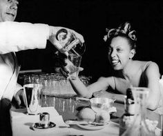Josephine Baker relaxes with a cocktail in Venice after a hard day's work in Photo: Getty Images. Josephine Baker, Vanessa Paradis, Kate Moss, Drake, Rent Party, Vintage Black Glamour, Cotton Club, Vogue, Harlem Renaissance