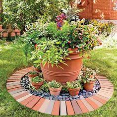 Pot w tiny pots + red and grey alternating bricks set in baguette Style -my jardín