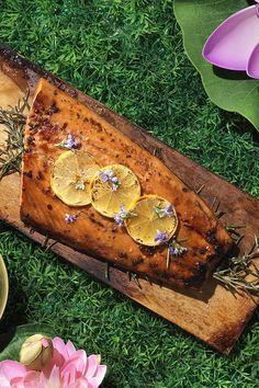 Recipe including course(s): Entrée; and ingredients: brown sugar, fresh rosemary, lemon, orange juice, salmon fillet, Soy Vay® Veri Veri Teriyaki® Marinade & Sauce