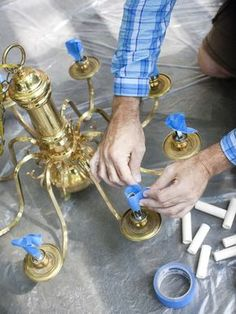 spray paint brass chandelier. http://www.hgtv.com/kitchens/how-to-modernize-a-traditional-brass-chandelier/index.html