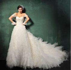 Strapless Tulle Ball Gown with Ruffle Skirt: Create your inner romantic look through this ethereal tulle ball gown.