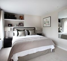 small bedroom furniture ideas neutral colors wall shelves wall mirror black bedside tables