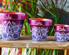 These handpainted bohemian planters take terra cotta pots to a whole new level! They are perfect as vibrant wedding/party favors and centerpieces. Give these pots away as party favors with a planted succulent to create a natural bohemian feel. They are also perfect for adding hand crafted beauty to any home! If you are in need of a custom order send me a convo. I would love to work with you! This listing is for three hand painted terra cotta pots. Please choose which size you would like ...