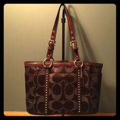 """Beautiful Brown Canvas COACH Bag Previously loved 💞 Gorgeous brown, signature canvas Coach bag w/ shimmer effect & stud detail. 14""""L X 9""""H - some signs of wear on straps and leather details. Inside of bag needs cleaned out, previously used. Every girl deserves a beautiful bag like this! 😍 Coach Bags Shoulder Bags"""