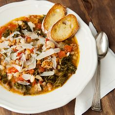 A hearty stew for cooler weather: cannellini beans, kale, tomatoes, and Italian sausage.