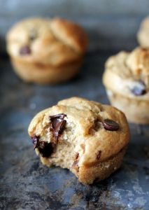 Lightened up banana chocolate chip muffins made with greek yogurt. No butter used and they're naturally sweetened with honey instead of sugar!