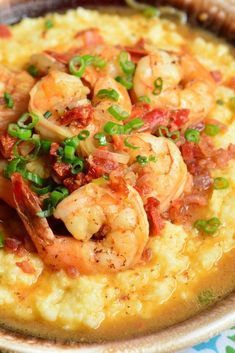Shrimp and Grits is a wonderful southern classic that consists of buttery, cheesy grits topped with juicy shrimp that's been cooked with bacon and sub dried tomatoes. #shrimp #dinner #easydinner #grits Charleston Shrimp And Grits, Shrimp And Cheesy Grits, Shrimp N Grits, Shrimp Recipes For Dinner, Seafood Dinner, Appetizer Recipes, Seafood Gumbo, Cajun Recipes, Fish Recipes