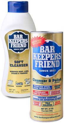 Bar Keepers Friend!  Good Stuff for cleaning black scuff and scratches off my white plates.