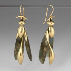 """These whimsical Gabriella Kiss 'Articulated Wasp' earrings feature 14k green gold wasp bodies, with movable labradorite wings. The artful earrings are capped with her signature arched element. The perfect pair for a nature lover!<br><br>Total length measures 2.2"""""""