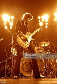Photo of Jimmy PAGE and LED ZEPPELIN; Jimmy Page performing live onstage, playing Gibson Les Paul guitar