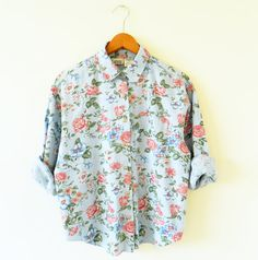 The prettiest vintage chambray floral shirt! Buttons to neck. Buttoned, pleated…