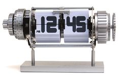 The Bomba Alarm Clock boasts a technical design with moving gears and blue illumination for night time viewing.   $72.00
