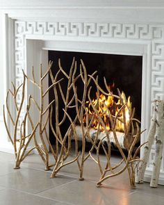 "Golden Branch Fireplace Screen at Horchow. Reg 475. Sale 382 Handcrafted of iron. Hand-painted Italian-gold finish. For decorative use or use with gas logs only. 48.75""W x 9""D x 32""T."