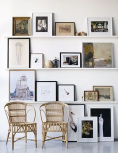 gallery wall with open shelves. Leaning pictures instead of nailing to wall in a grid, allows you to move them around, add and replace, easily