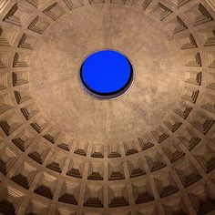 The Pantheon dome with the oculus to the sky. The oculus and the entry door are the only source of light in the interior. Almost 2000 years after it was built, the Pantheon's dome is still the world's largest unreinforced concrete dome.