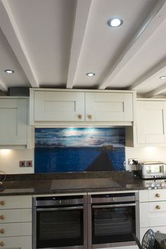 This splashback was designed from a photo sent by the client that was taken on a recent holiday. They wanted the sight put into artwork, but wanted something that was beautiful. As a kitchen splashback, the photo was able to be transformed into glass art and was placed behind the cooker. Now when the two wake up every morning they can see their past memories in the glass.