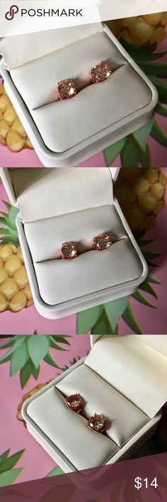 Rose gold morganite stud earrings Cute rose gold plated studs with champagne colored morganite stones. See my listings for matching rings, I discount bundles! All jewelry comes with gift packaging. Jewelry Earrings