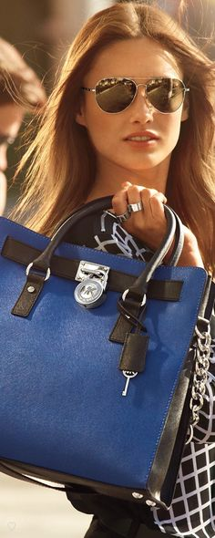 Michael Kors . I have the plain black but this blue is now my favorite!  Wow