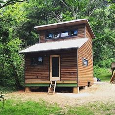 Tiny house in #Asheville built by @nanostead #interiors #interiordesign #architecture #decoration #interior #home #design #camper #bookofcabins #homedecor #house #decor #prefab #diy #campervan #compactliving #fineinteriors #cabin #shed #tinyhomes #tinyhouse #cabinfever #foodtruck #tinyhousemovement #airstream #treehouse #cabinlife #cottage