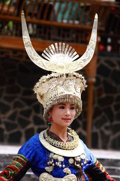 Miao women's extravagant silver handcrafted head gear, some with huge horns, flowers and tiny beads are only worn within their community. Traditional Fashion, Traditional Outfits, Types Of Clothing Styles, Period Outfit, Child Face, Korean Outfits, World Cultures, Chinese Style, Headdress