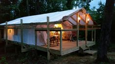 Canvas Wall Tent built on platform with hitching rails.