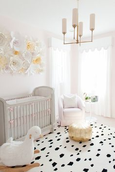 Baby Girl Nursery design, black and white spotted rug, gold tuft, light pink walls // Palm Beach Lately