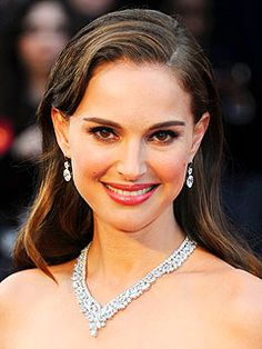 Natalie Portman paired her classic Dior gown with a Harry Winston diamond cluster necklace and 6-carat oval diamond drop earrings.