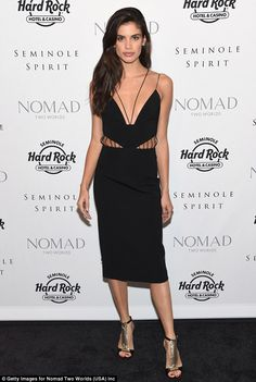Striking: Another Victoria's Secret beauty - Sara Sampaio - stunned in a black cut-out dre...
