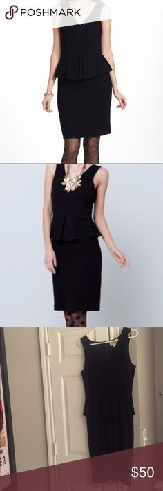 Anthropologie Ganni Black Peplum Dress Very flattering, stretchy peplum dress. Back zipper. Great condition. Anthropologie Dresses