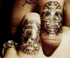 Whilst hand and finger tattoos (and neck and face tattoos) are not my thing, these two tatts are glorious! I think they are absolutely fab :)