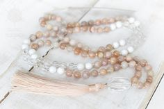 This yoga mala necklace is made with natural sunstone, crystal quartz, shell and silver. Each bead is individually hand knotted. It has an ability to balance mental and physical states, thus increasing happiness and optimism. Lifts depression. Brings good luck, fortune and prosperity.  Malas are worn on the neck or left wrist while not in use. It may also serve as a nice accessory in everyday life or on some special occasions.  DETAILS: • Length: 20 (50cm) | Diameter: 31 (79cm) • 108 beads…