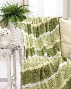 Light throw with a spring-inspired color story. Shown in Bernat Satin.